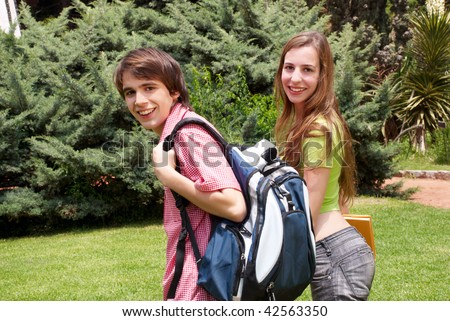 Portrait  happy young students in park - stock photo