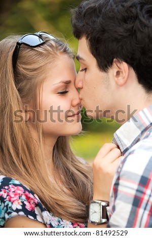 Portrait happy young teenage couple outdoor - stock photo