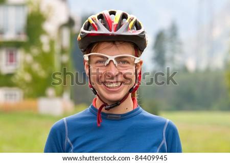 Portrait if smiling pretty young female biker - stock photo