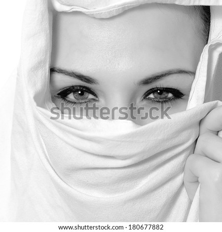 portrait in black and white of a beauty arabian girl with hijab - stock photo