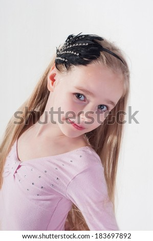 Portrait in blond girl with long hair in studio - stock photo