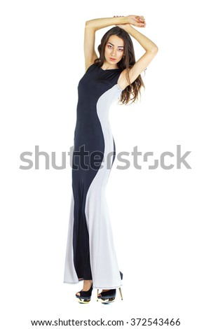 Portrait in full growth of a young woman in long evening dress, isolated on white - stock photo