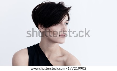 Portrait in profile of beautiful fashionable girl with interesting hair - stock photo