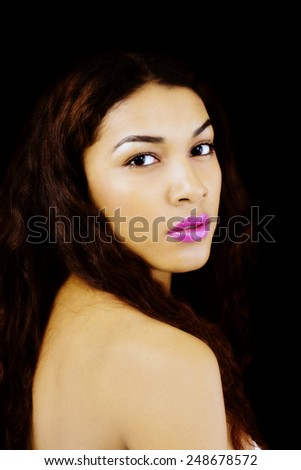 Portrait Latina Woman Looking Over Bare Shoulder