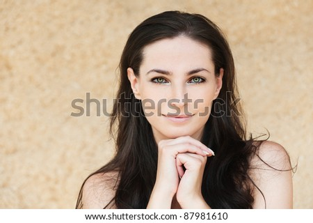 portrait lovely woman smiling dark-haired bare shoulders - stock photo