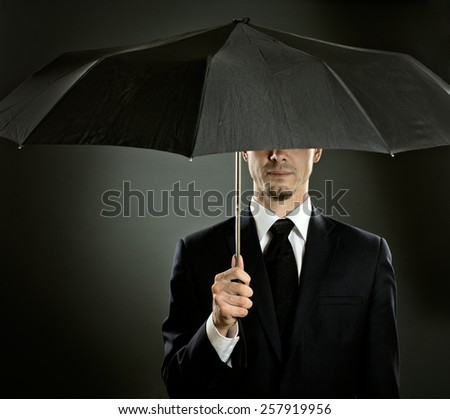 portrait  man the  beautiful  man in blue costume with umbrella,  special-service agent  - stock photo