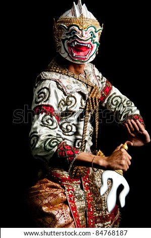 Portrait marked Male of Thai dancing art with black background. Low key portrait Siam