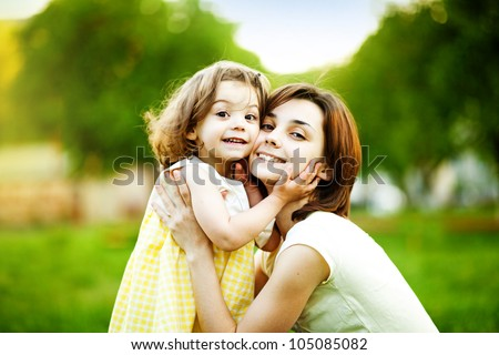 Portrait  mother and daughter - stock photo