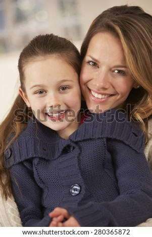 Portrait mother and daughter at home - stock photo