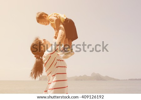 Portrait mother and little son on the beach with color tone effect - stock photo