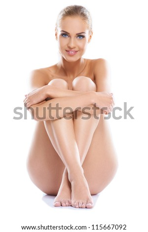 Portrait of a adorable young woman with a gorgeous figure, sitting isolated - stock photo