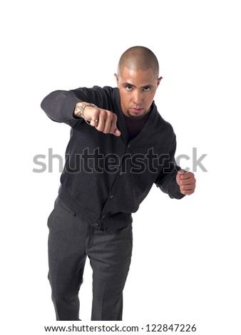 Portrait of a African American businessman ready to fight over white background - stock photo