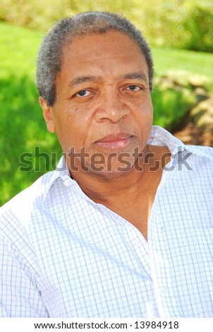 Portrait of a african american male outdoors. - stock photo