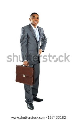 Portrait of a african business man carrying a suitcase on white background
