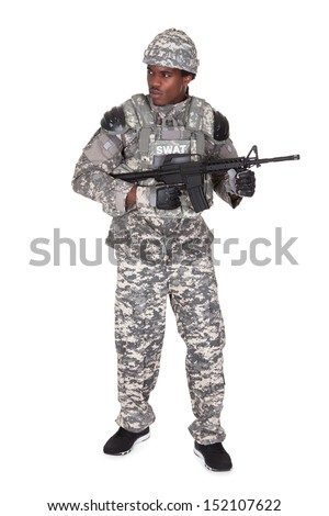 Portrait Of A African Soldier With Gun Isolated Over White Background - stock photo