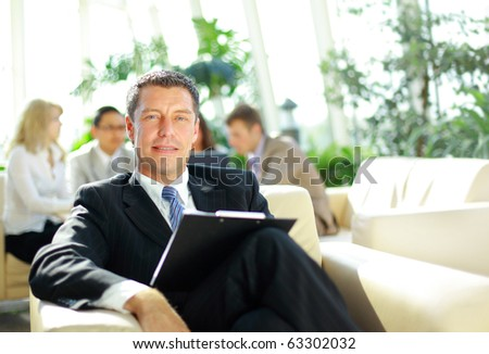 Portrait of a ambitious business man in an office environment - stock photo