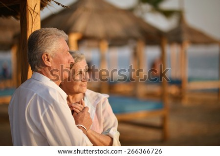 Portrait of a amusing old couple on vacation - stock photo