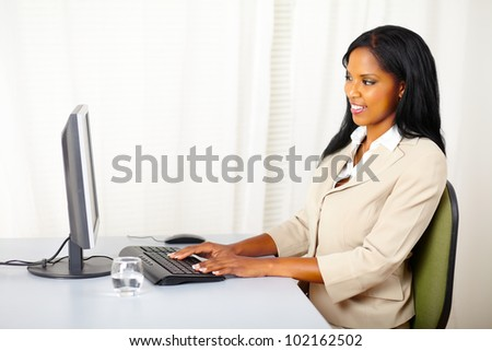 Portrait of a attractive businesswoman using a computer - stock photo