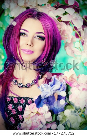 Portrait of a attractive girl among the flowers. Spring. Summer. - stock photo