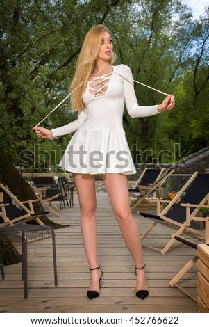 Portrait of a attractive sensuality and beautiful young adult blonde woman in the park