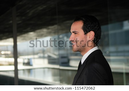 Portrait of a attractive young businessman smiling - stock photo