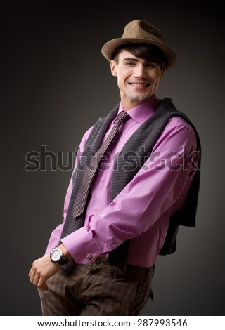 portrait of a attractive young male model smiling, retro clothes -  studio shoot - stock photo