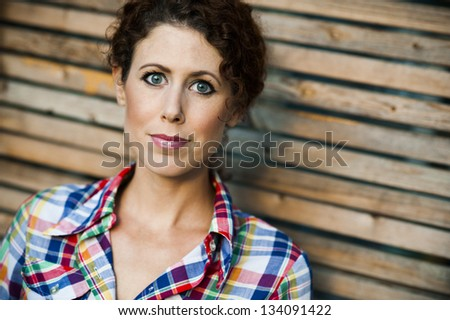 portrait of a attractive young woman with curly hair - stock photo