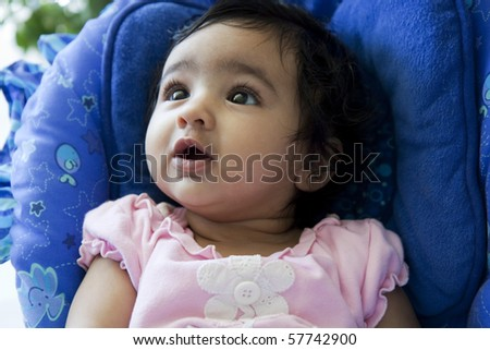 Portrait of a Baby Girl Gazing Sideways and Up - stock photo