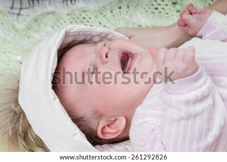 Portrait of a baby girl who is crying - stock photo