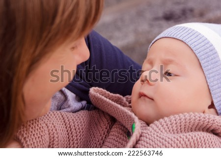 Portrait of a baby in the arms of mother
