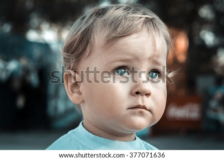 Portrait of a baby in the park - stock photo