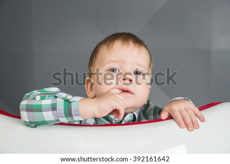 Portrait of a baby sucking finger - stock photo