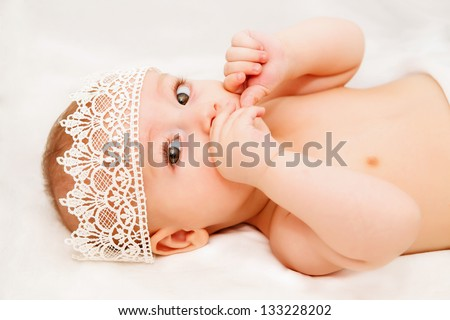 Portrait of a baby wearing a crown - stock photo