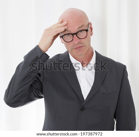 portrait of a bald-headed man with a headache - stock photo