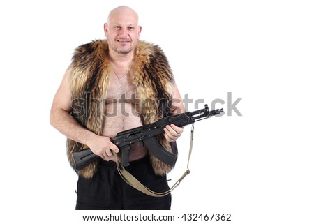 Portrait of a bald man in a fur vest with a gun in the hands on a white background studio