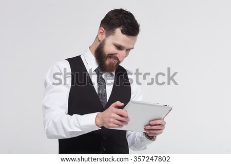 Portrait of a bearded business man using a tablet. On white background.