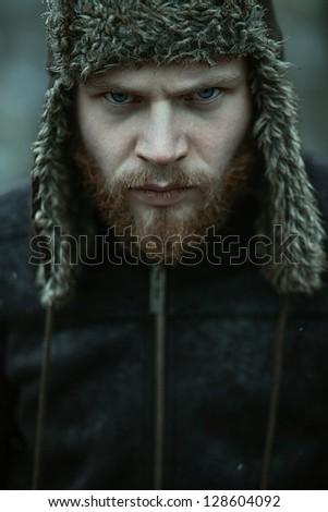 Portrait of a bearded man in a cap - stock photo