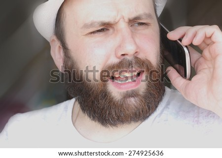 portrait of a bearded man smile leisure talking on the phone