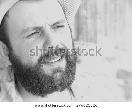 portrait of a bearded man smile leisure talking on the phone - stock photo