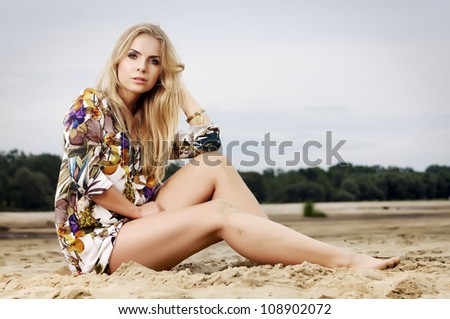portrait of a beautiful adult sensuality blonde woman - stock photo