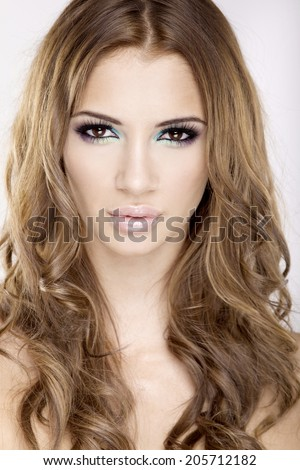 portrait of a beautiful adult sensuality brunette woman in multicolor makeup