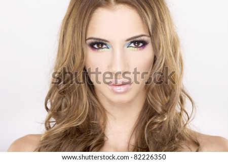 portrait of a beautiful adult sensuality brunette woman in multicolor makeup - stock photo