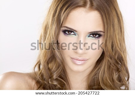 portrait of a beautiful adult sensuality brunette woman in multicolor makeup isolated on white background  - stock photo