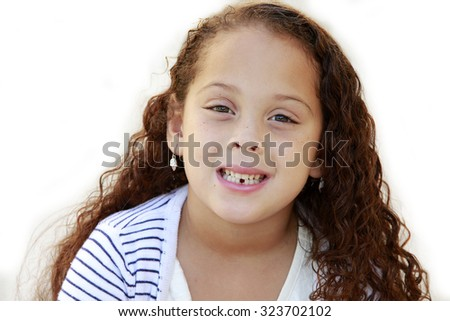 Portrait of a beautiful African American little girl isolated on white with missing tooth - stock photo