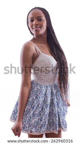 portrait of a beautiful African woman with braids in a seductive dress posing on an isolated background - stock photo