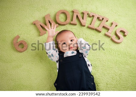 Portrait of a beautiful and confident asian baby boy. 6 months. age concept. - stock photo