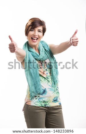 Portrait of a beautiful and happy woman with thumbs up, isolated over white background - stock photo