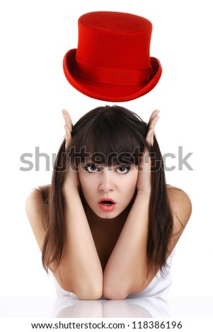 Portrait of a beautiful and playful girl with long hair and red hat - stock photo
