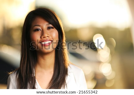 Portrait of a beautiful asian girl. Shallow DOF. - stock photo