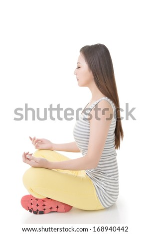 Portrait of a beautiful asian woman in yoga pose. Isolated on the white background. - stock photo